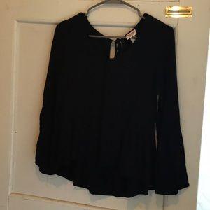 Black peplum top with bell sleeves